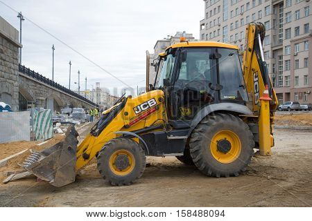 MOSCOW, RUSSIA - SEPTEMBER 07, 2016: The JCB-3CX excavator loader on reconstruction of an automobile outcome at Bolshoy Kamenny Bridge
