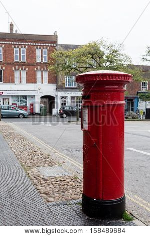 Winslow, Buckinghamshire, United Kingdom, October 25, 2016: Royal Mail Red Post Box On Market Square