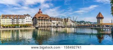 LUZERN,SWITZERLAND - SEPTEMBER 3,2016 - View at the Luzern city with Chapel bridge over Reuss river. Luzern is a city in central Switzerland.