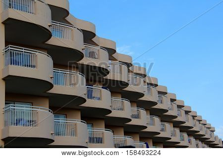 Windows and balconies. Modern house with many windows and balconies.