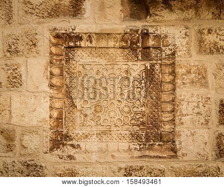 Armenian khachkar carving stone carving art on the wall in the courtyard of the Cathedral of Saint James in the Armenian Quarter of Jerusalem Israel
