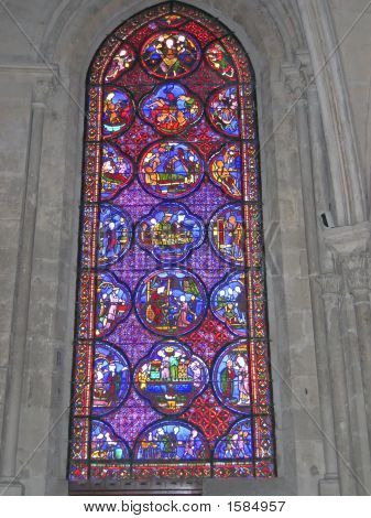 A Blue And Red Stained Glass Window In The Choir Of The Cathedral, Bourges, France