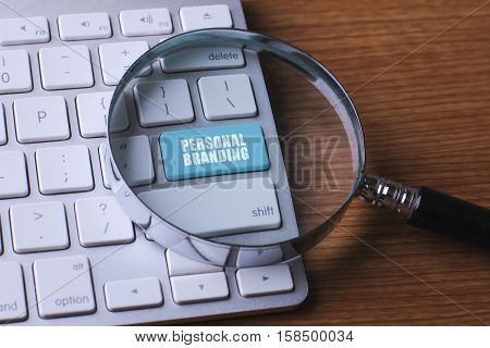 Advertising concept: computer keyboard with word Personal Branding selected focus on enter button background