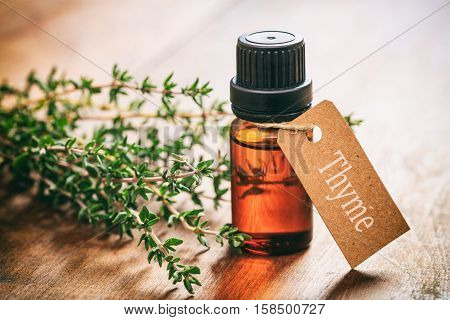 Thyme Oil On Wooden Background