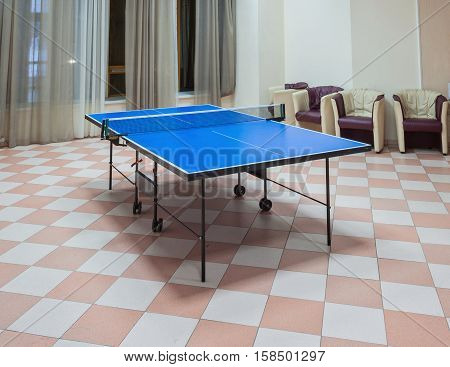 Old Style Photo. Ping-pong tennis table with Paddles on the floor