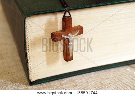 Holy Bible and a wooden cross with Jesus