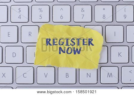 Register now./ Register now card with information on the keyboard