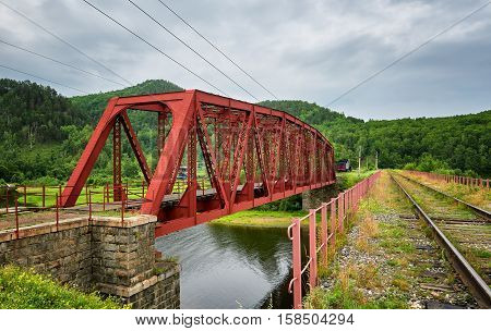 Old metal bridge on Circum-Baikal Railway. Irkutsk region. Russia
