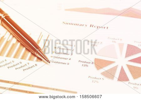 Close up business concept Pen is on summary report on paperwork on table office.