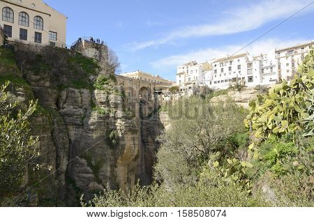 The New Bridge And white houses over the gorge in Ronda Andalusia Spain