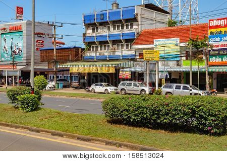 Surat Thani Thailand - December 26 2015: Everyday street life of the provinces of Thailand. Lifestyle and culture of Suratthani. Street scape view of the bustling tourist town.