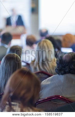 Business People Concepts and Ideas. Group of People Listening To The Host Lecturer During Business Conference.Vertical Image