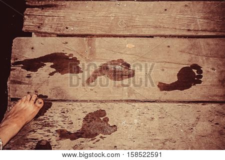 Footprints.Image of footprints left on the wooden dock