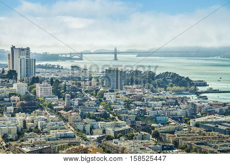 Aerial view of San Francisco skyline. Panorama of the Golden Gate Bridge, Fisherman's Wharf and North Beach from top of Coit Tower on sunny day, California, United States.