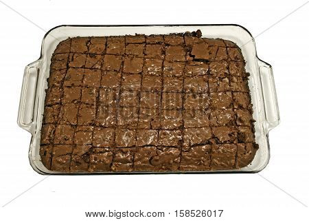 Freshly baked Brownies in a pan on a white background