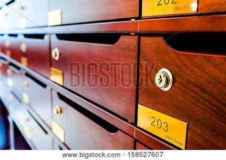 Wooden Mailboxes In The Entrance Hall Of A Residential House