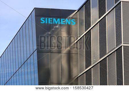 Wallisellen, Switzerland - 20 November, 2016: upper part of the Siemens office building. Siemens AG is a company headquartered in Berlin and Munich, it is the largest engineering company in Europe.
