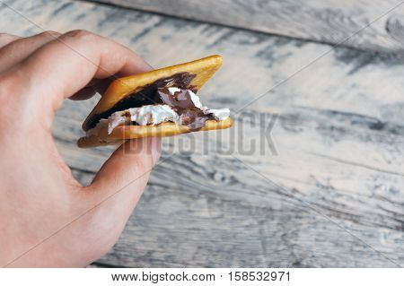Sweet dessert. Smore. Chocolate, marshmallow and cracker.