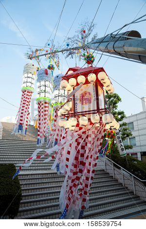 Aichi JAPAN - August 6, 2016: Traditional japanese paper decoration on bamboo poles. Anjo Tanabata festival Aichi Japan. evening time in motiom blur