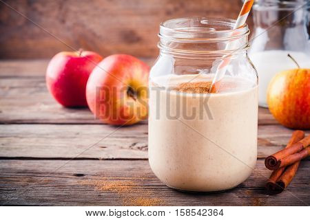 Smoothies With Red Apple And Cinnamon In A Glass Mason Jar