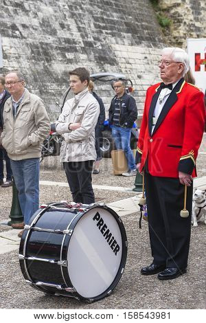 Amboise, France - June 2016: Bollington brass band drummer at street contest in Amboise