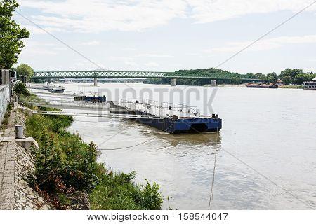 Metallic mooring for boats and bridge over the Danube River in Bratislava City Slovak republic. Harbor scene. Travel destination.