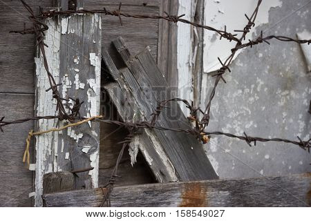 old abandoned grey wooden fence barbed wire