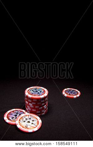 Pile Of Red Poker Chips On Black Background