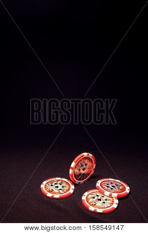 Heap Of Red Poker Chips On Black Background
