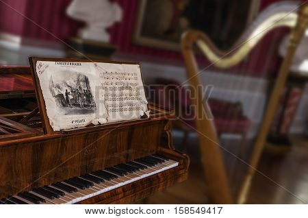 Amboise, France - May 2016: The harp and the piano in musical salon