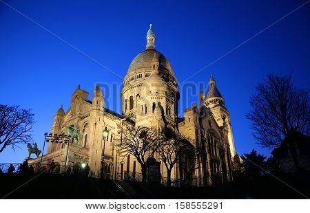 Basilica of Sacre Coeur at night in Paris France