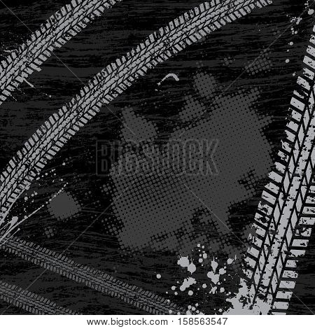 Black background with gray tire tracks and ink blots