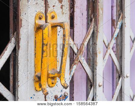 Yellow steel door handles of the old sliding door (door, handle, vintage)