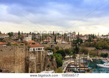 ANTALYA, TURKEY - NOVEMBER 8: Small marina and the historic Old Town of Antalya, known as Kaleici on November 8, 2016.