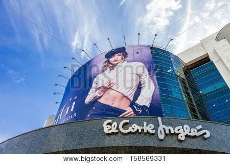 Lisbon, Portugal - October 19, 2016: El Corte Ingles, a high end Shopping Mall. Billboard or large ad in the main facade.