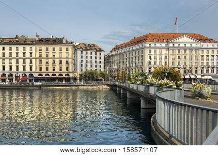 GENEVA, SWITZERLAND - September 04: view along the Pont des Bergues bridge at the facade of the Four Seasons Hotel des Bergues on September 04, 2016