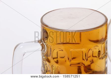large mug of light beer. tasty beverage in a pint of beer on a white background