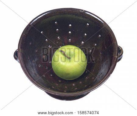 Green organic granny smith apple in ceramic berry bowl