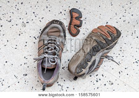 Top View Of Old Sport Shoes On Terrazzo Floor