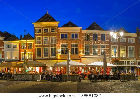 Markt square with typical Dutch houses in the center of the old city at night, Delft, Holland, Netherlands