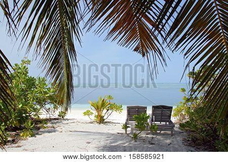 Deckchair on a Tropical Beach. Bodufinolhu (Fun Island) South Male Atoll Maldives