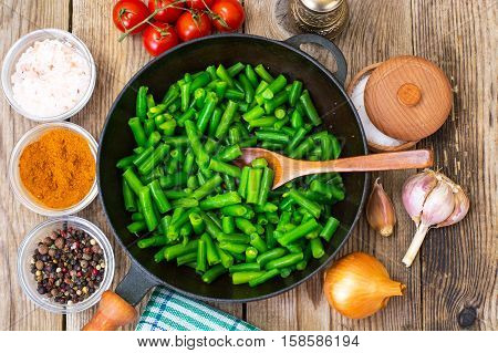 Green Beans on cast-iron frying pan. Studio Photo