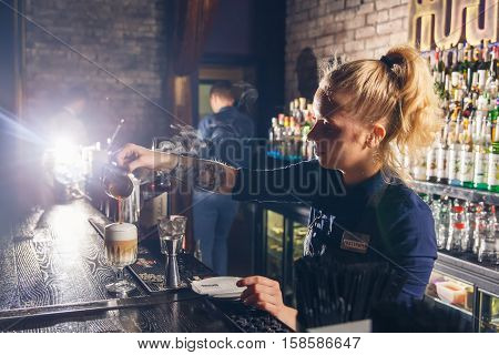 Woman Bartender Making An Alcohol Cocktail