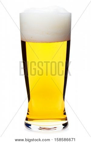 Full pilsner glass of pale lager beer with a large head of foam isolated on white background