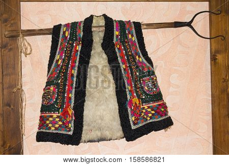 Traditional hutsul sheepskin vest hanging on the wall. Ukraine