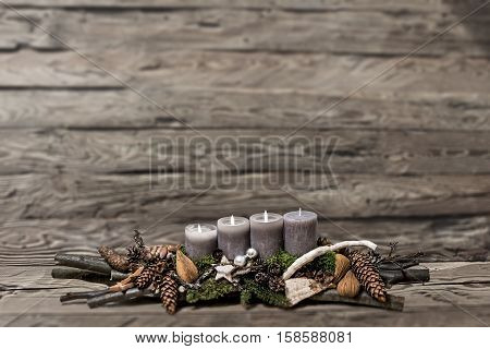 Merry Christmas decoration advent with burning grey candle Blurred background text space message 3rd
