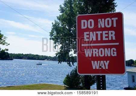 Do Not Enter, Wrong Way Sign with a Lake in the Background