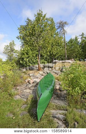 Canoe in Camp in the Shore on Kawnipi Lake in Quetico Provincial Park in Ontario