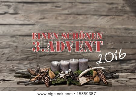 Merry Christmas decoration advent 2016 with burning grey candle Blurred background text message german 3rd