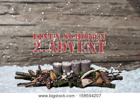 Merry Christmas decoration advent with burning grey candle Blurred background snow text message german 2nd